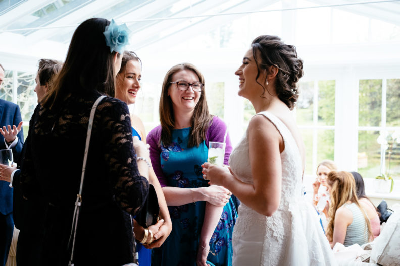 guests laughing with bride