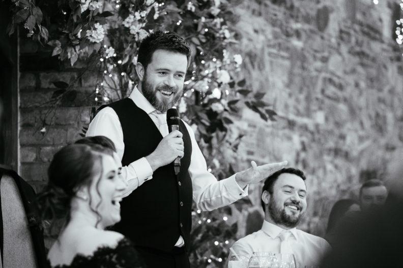 groom standing making a speech