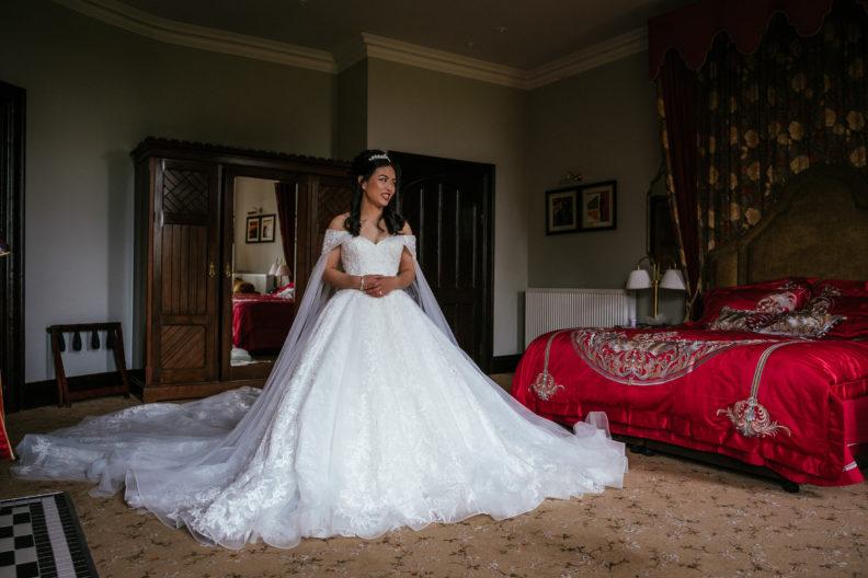bride standing in bridal suite