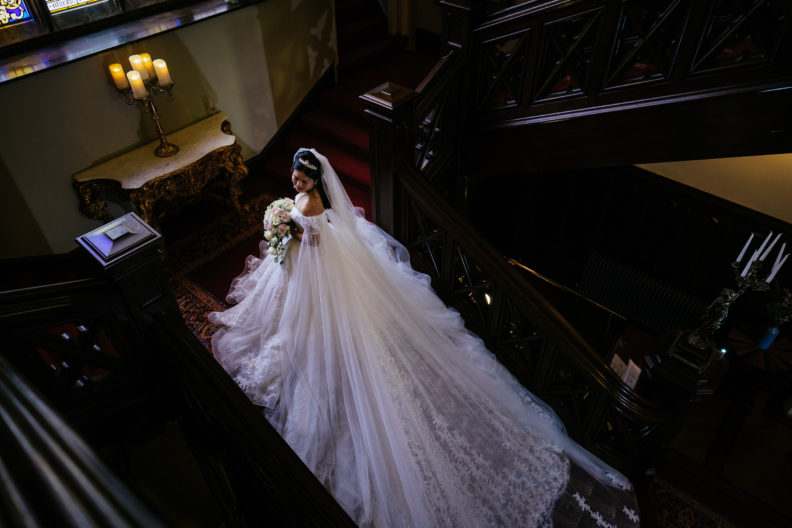 bride with long btrain on staircase at markree castle