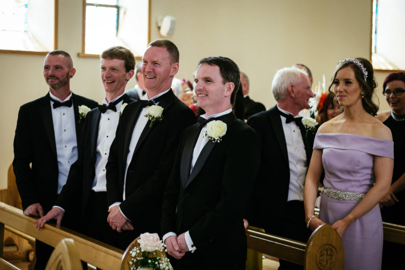 groom and groomsmen waiting for bride to arrive at church