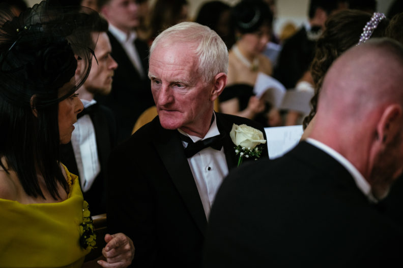 father of the groom talking