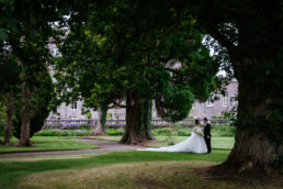 bride and groom standing in the garden at markree castle