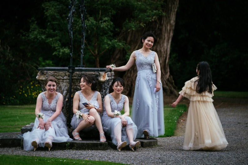 bridesmaids sitting laughing in markree castle