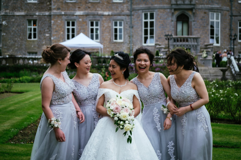 bride and bridesmaids laughing in garden at markree castle