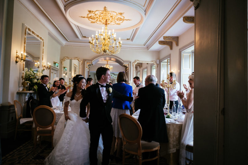 bride and groom entering reception room for dinner