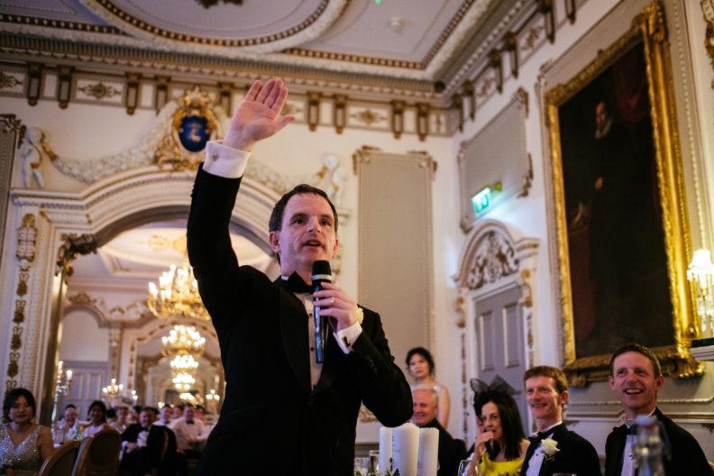 groom waving his arm