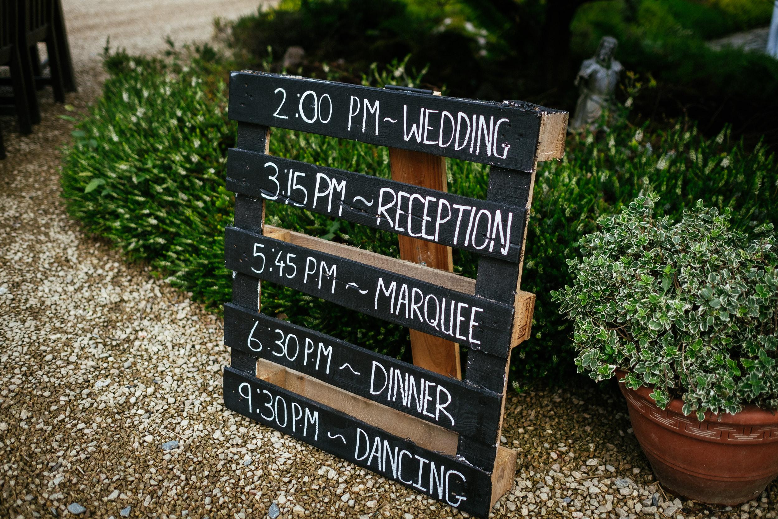 rustic notice board with wedding schedule
