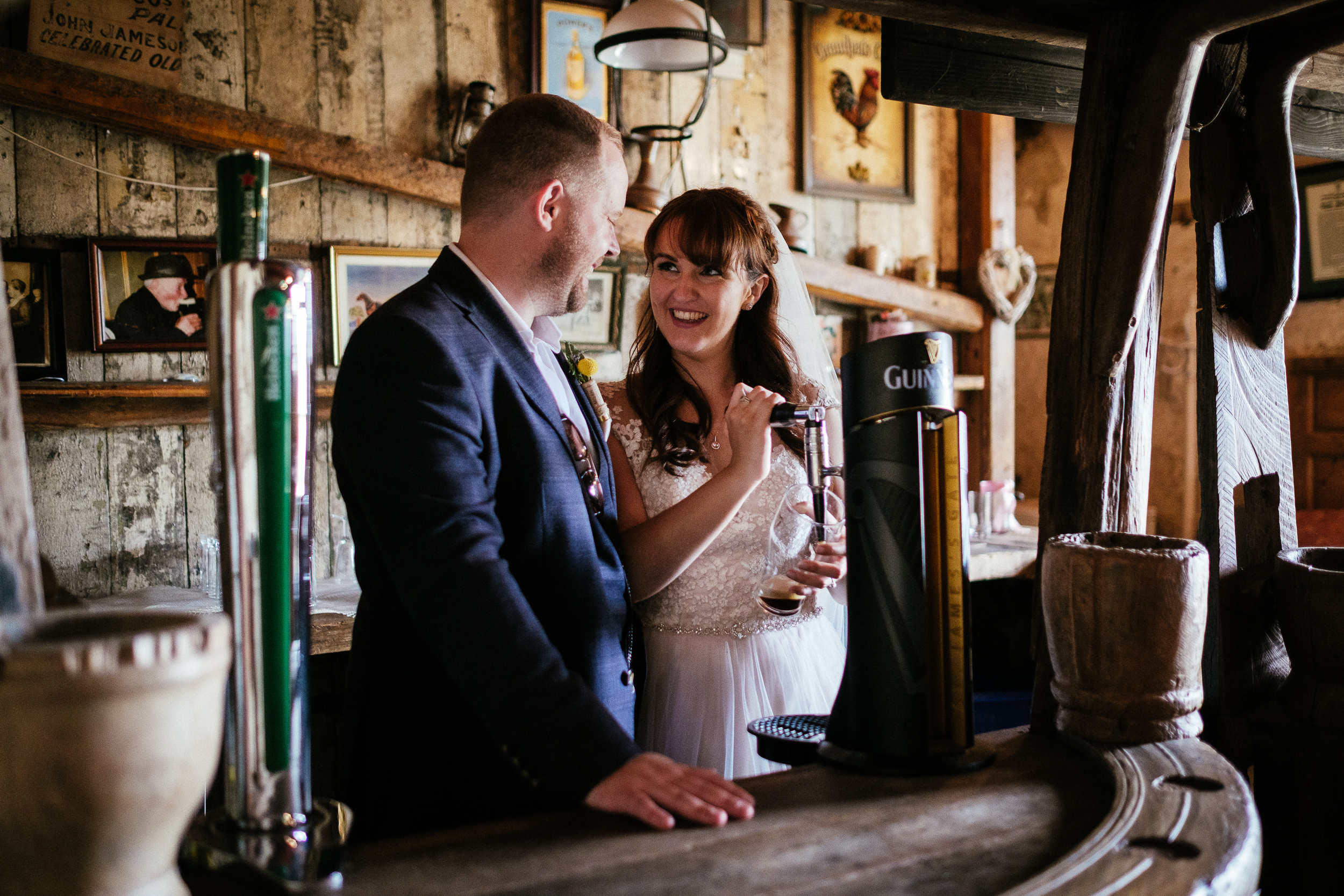bride pulling a pint of guinness