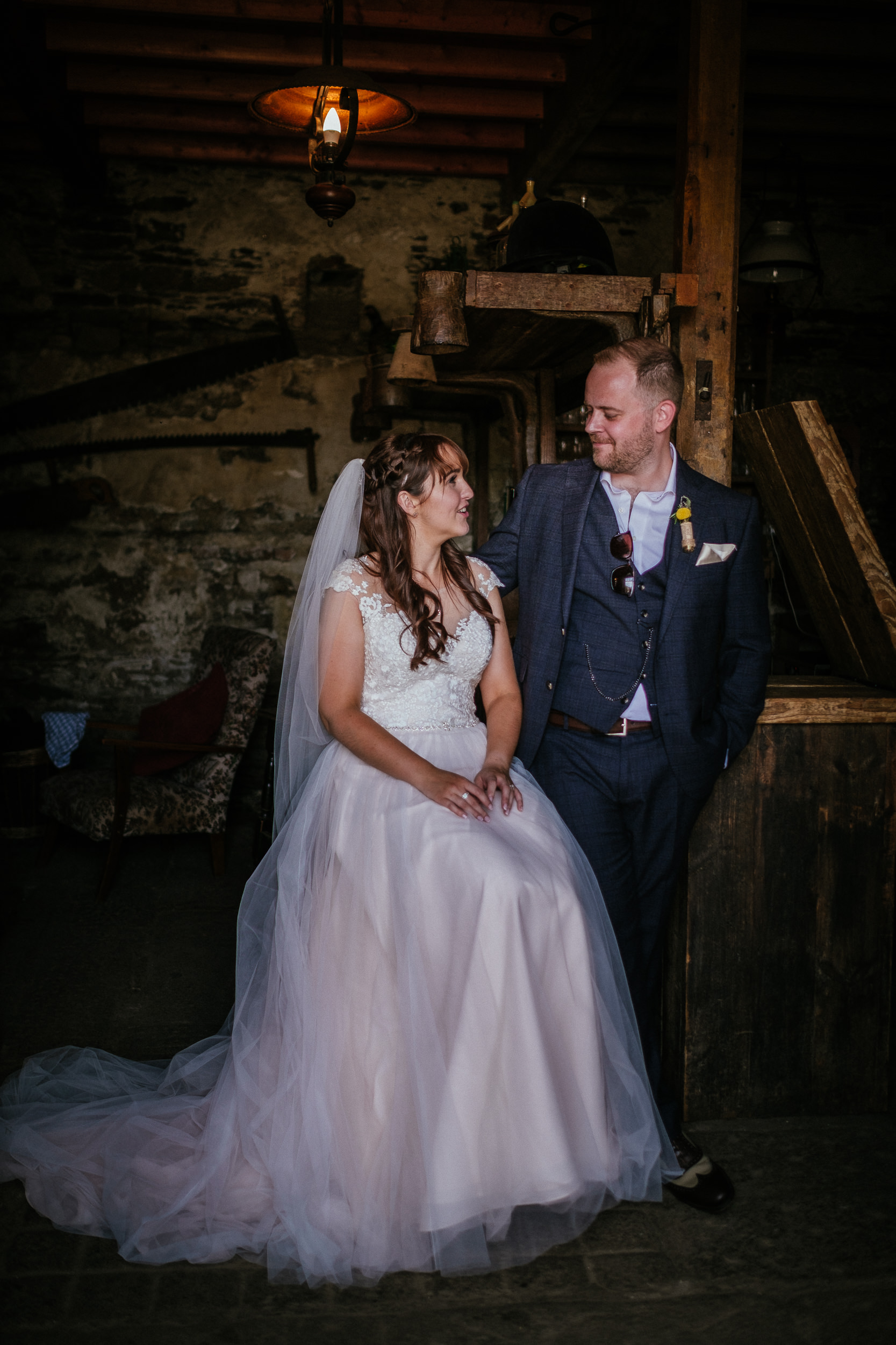 bride and groom sitting and standing in bar of ballybeg house