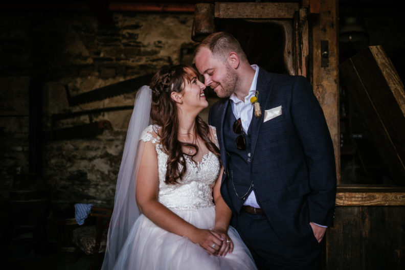bride and groom touching foreheads in bar of ballybeg house