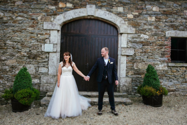 bride and groom standing outside shed door
