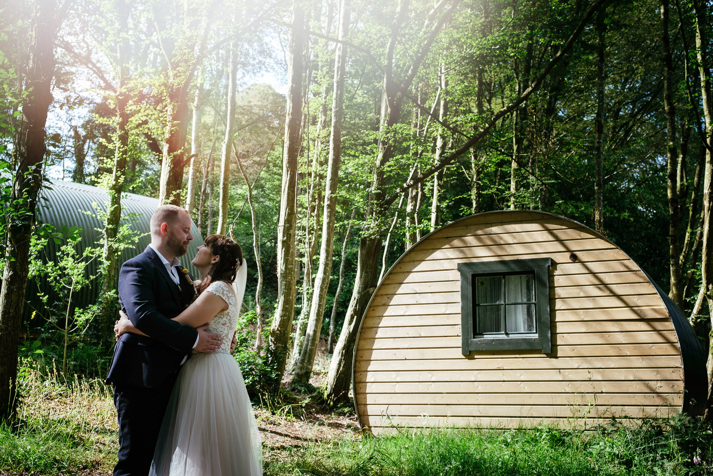 bride and groom by the pods at ballybeg house