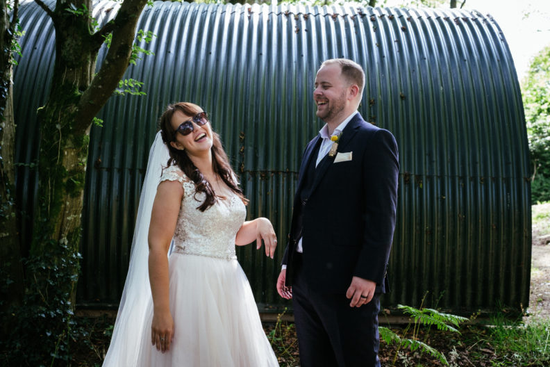 bride laughing wearing sunglasses