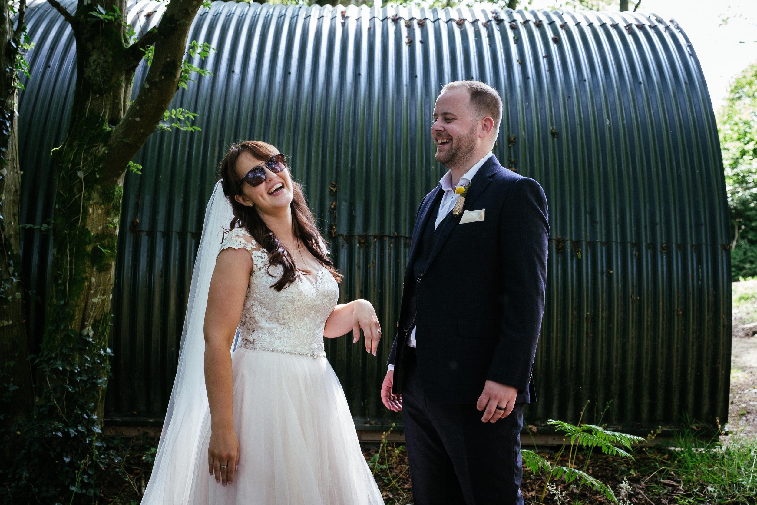 bride laughing wearing sunglasses