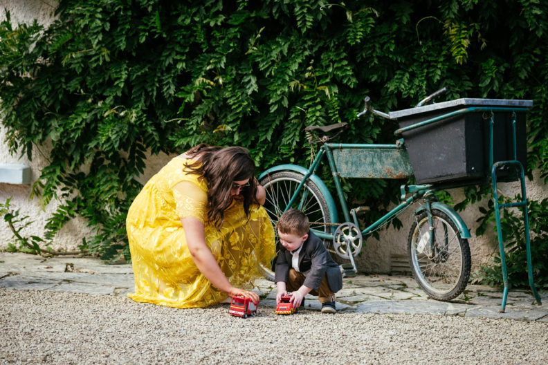 wedding guest playing with kid