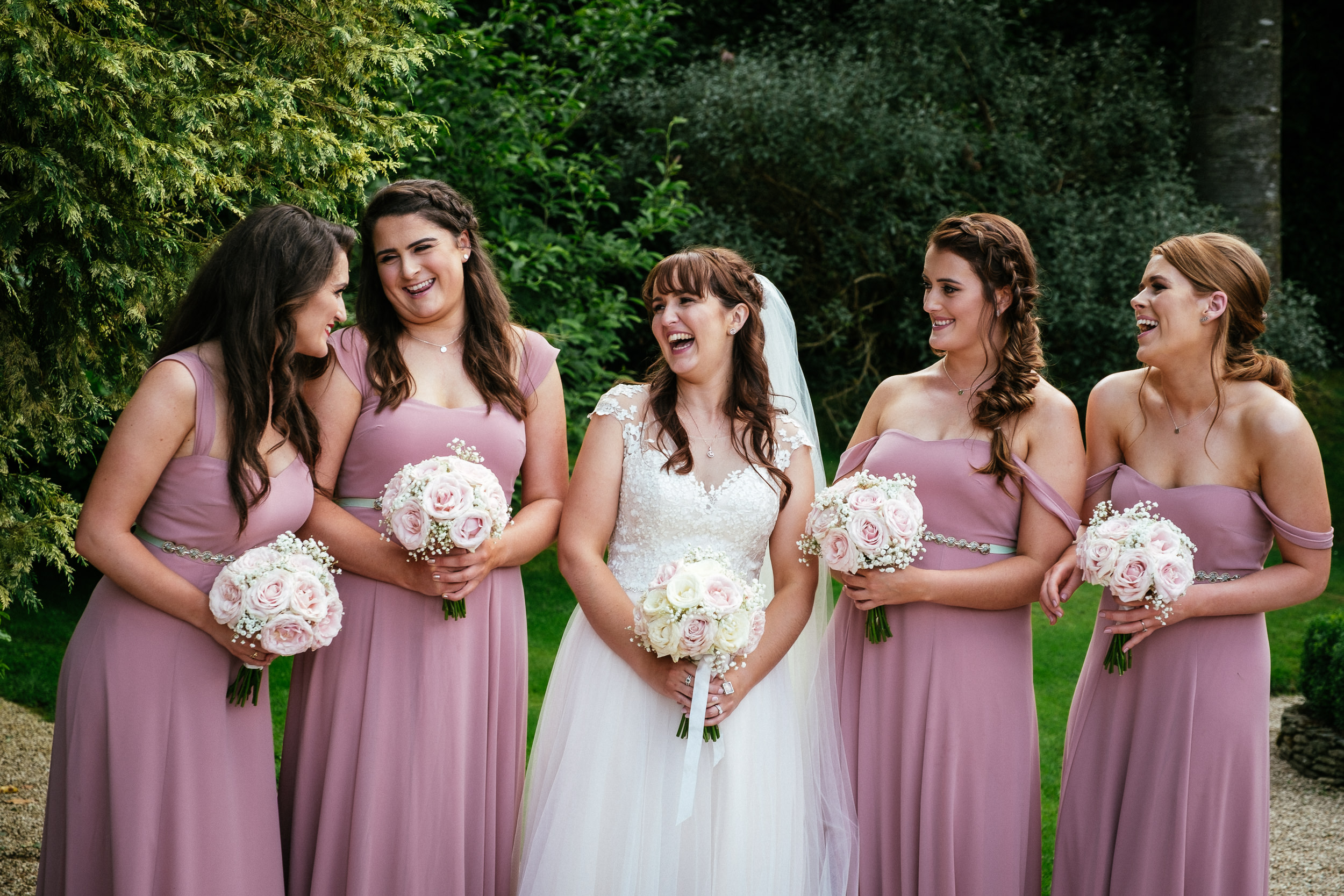 bride laughing with bridesmaids at ballybeg house wicklow
