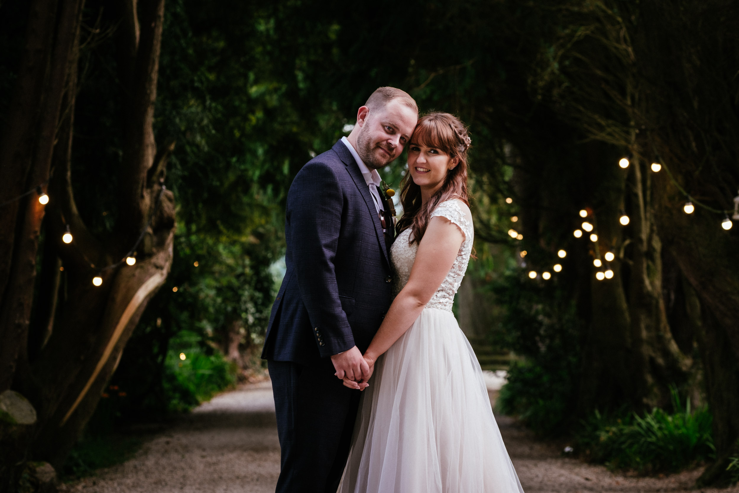 bride and groom posing at ballybeg house wicklow