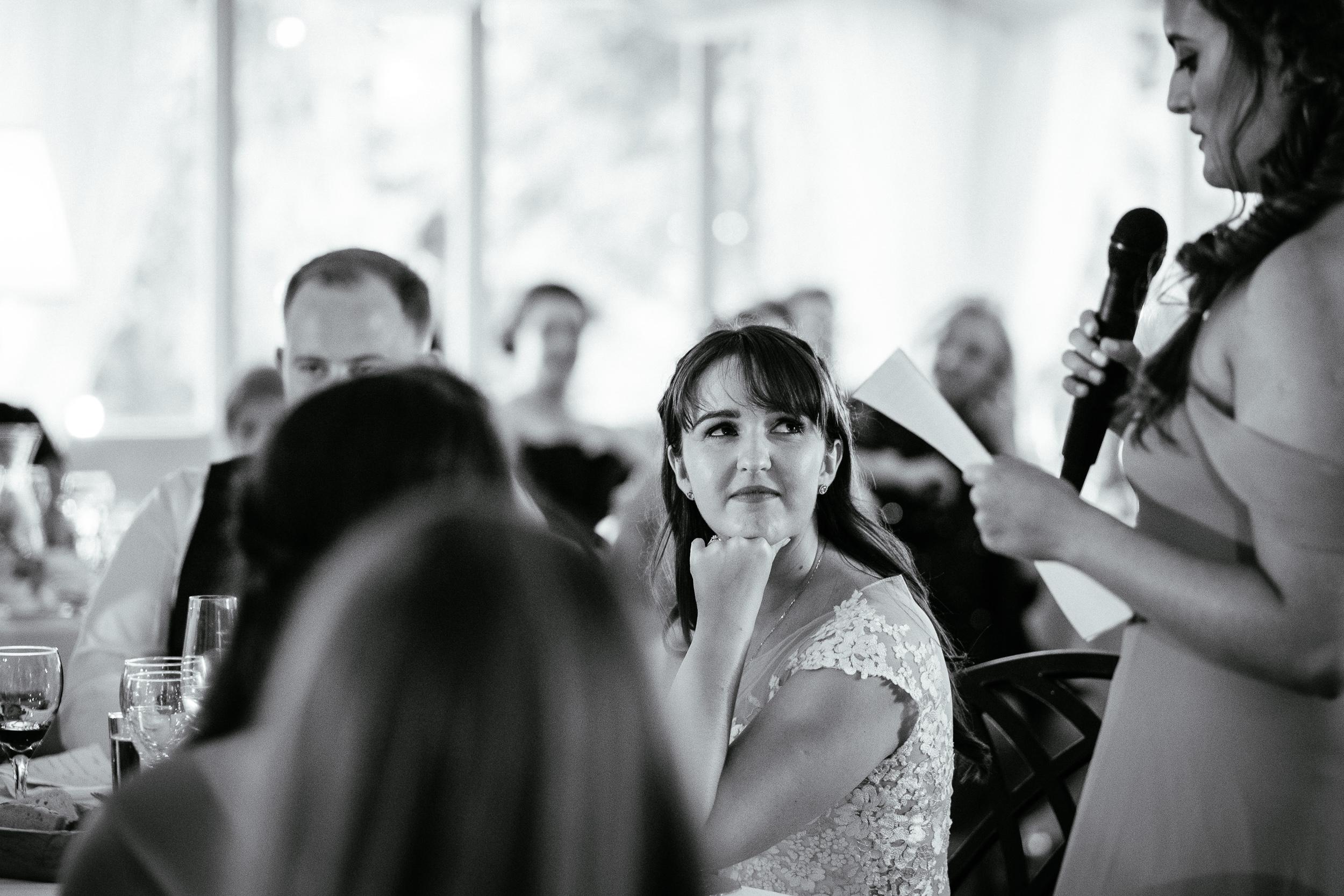 bride looking at bridesmaid