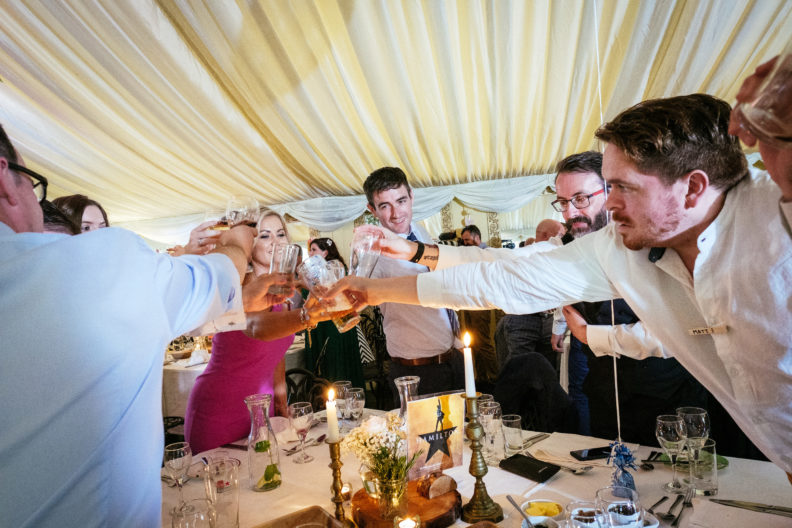 guests toasting during speeches