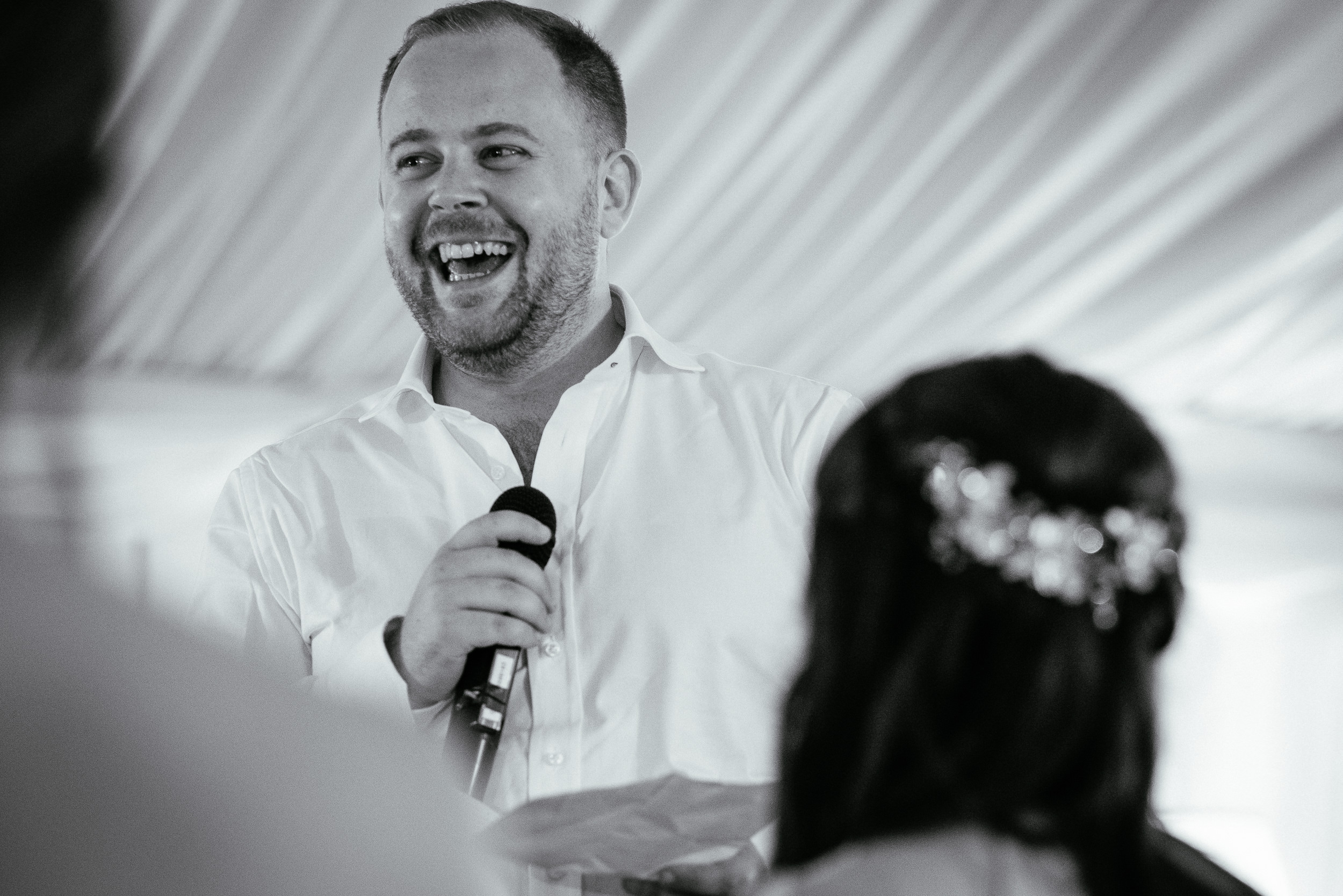 groom laughing during his speech