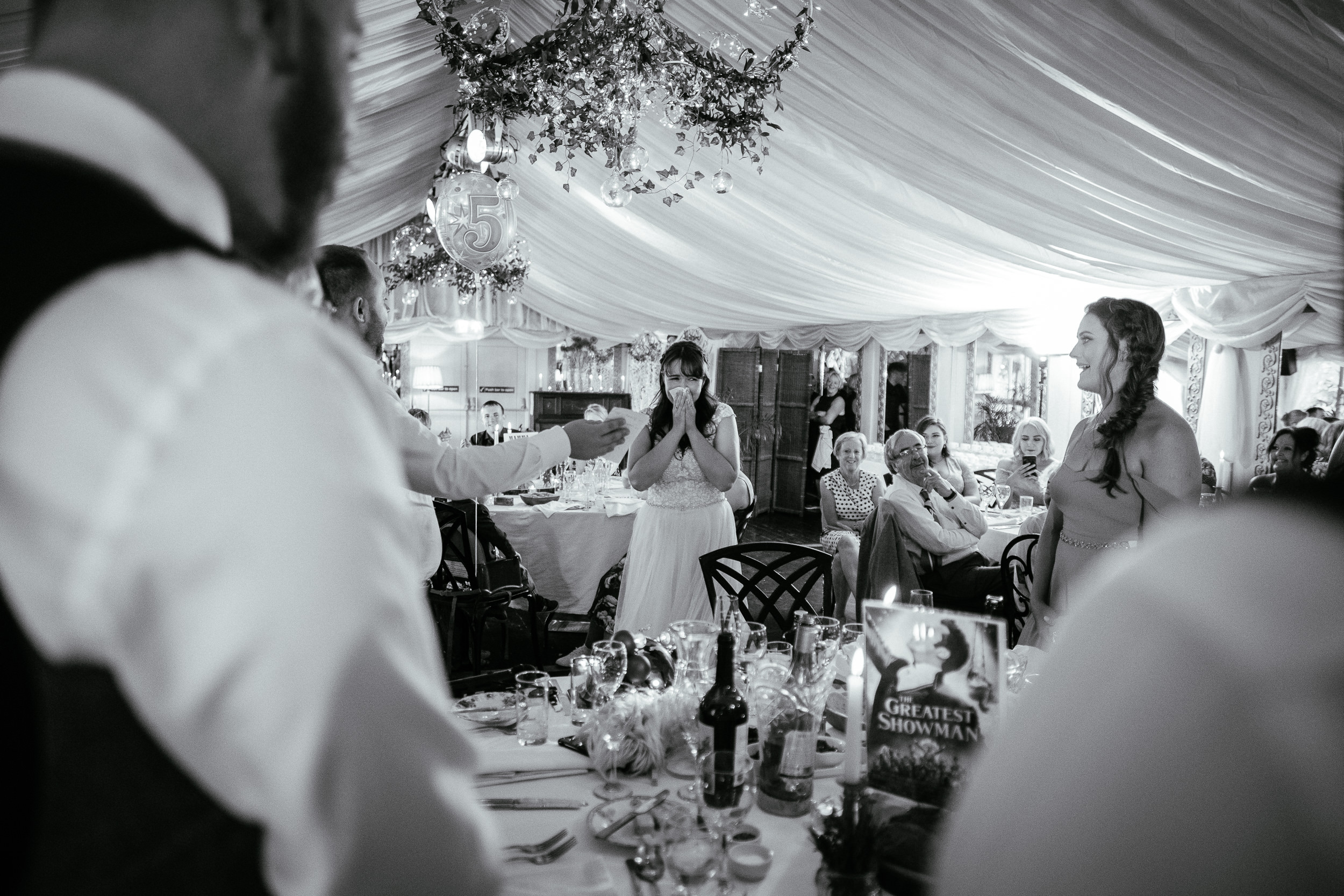 bride holding hands to mouth during speeches