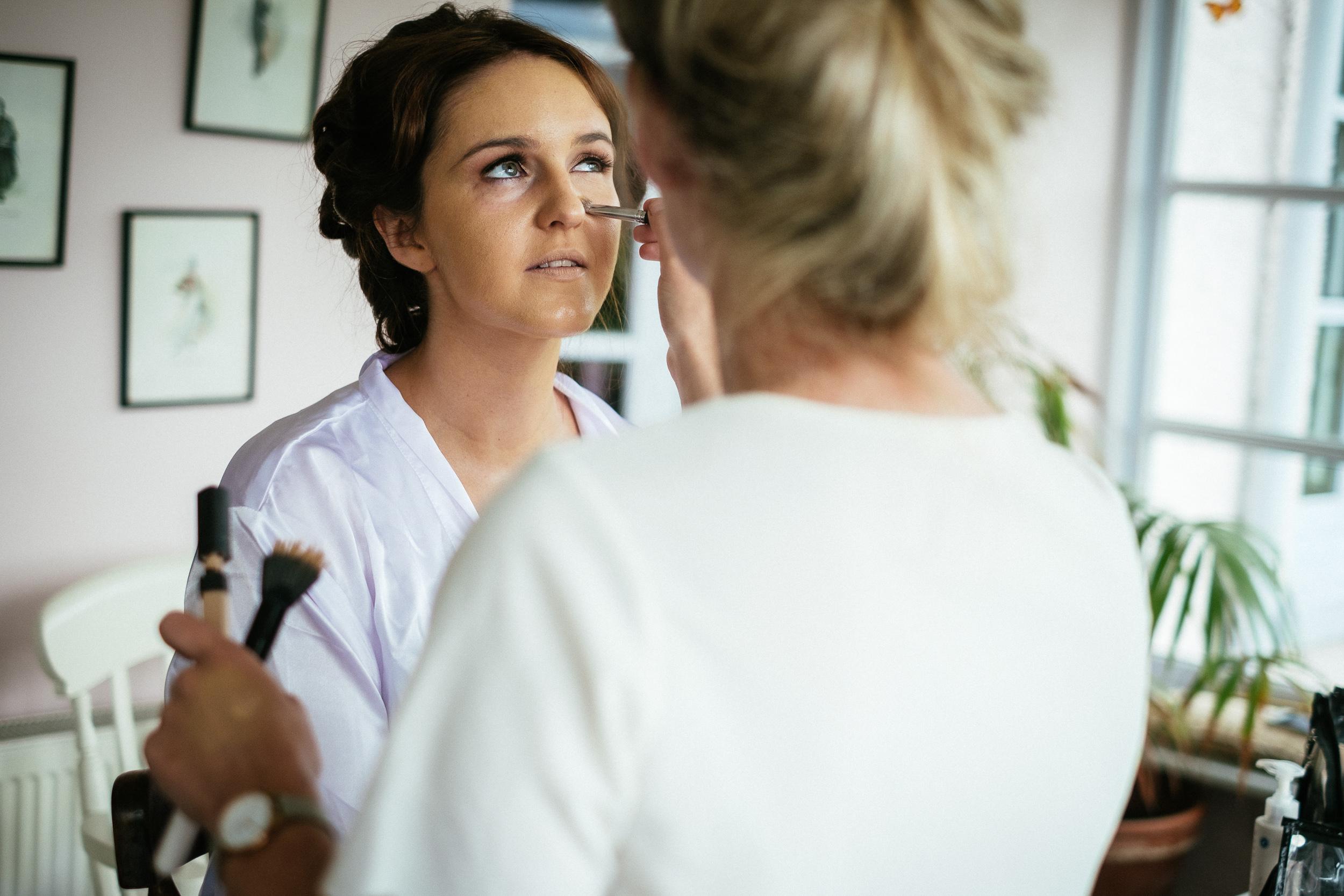 bride having makeup applied at ballybeg house
