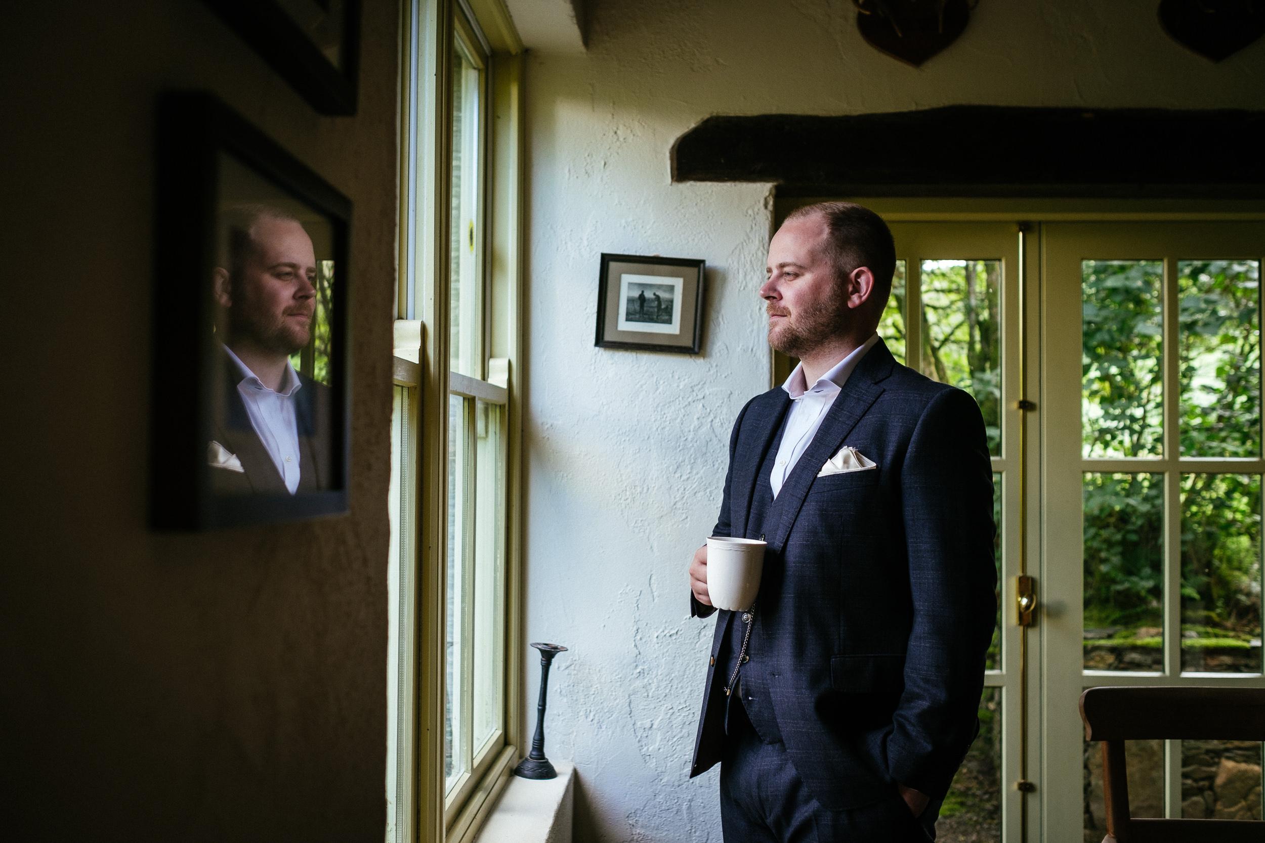 groom having a cup of tea