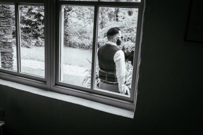 groomsman standing outside window