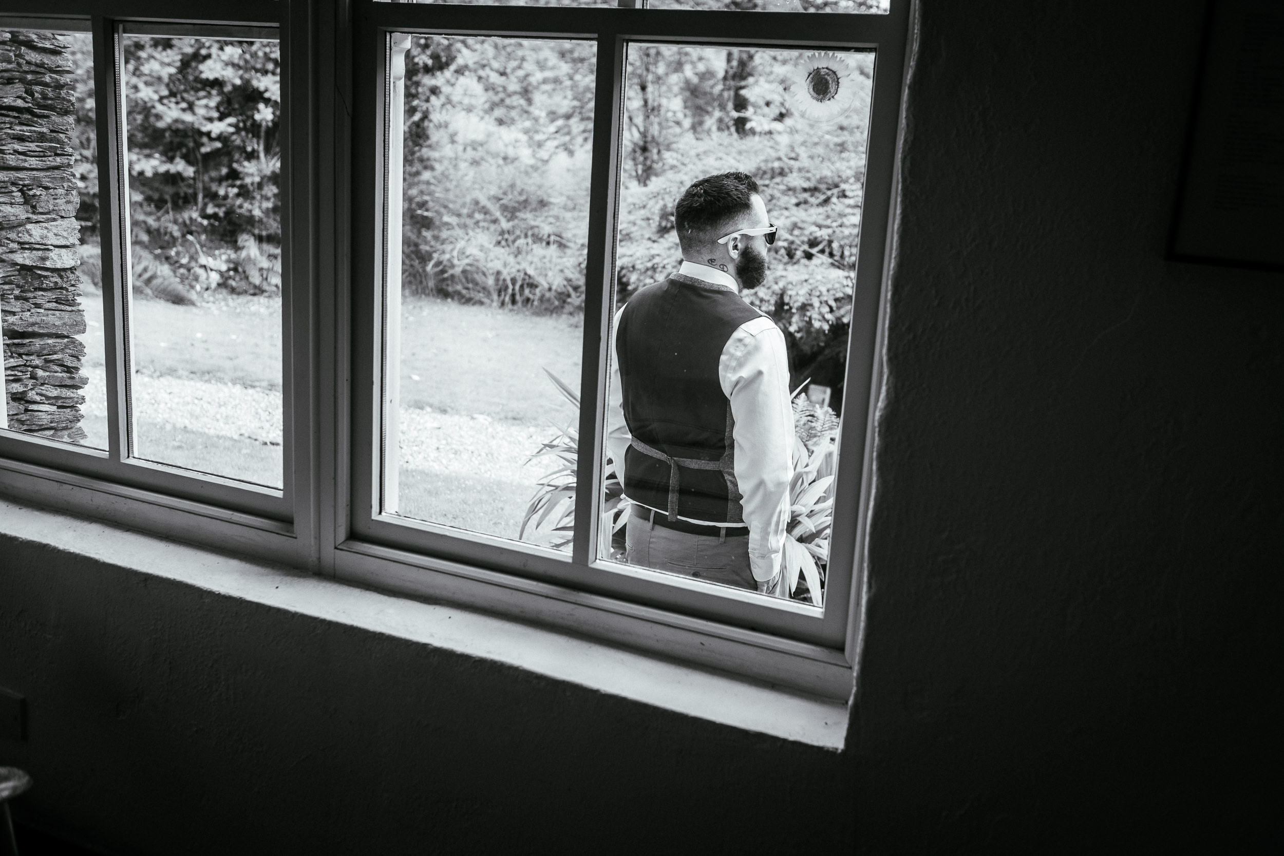 groomsman standing outside window