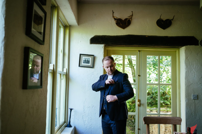 groom adjusting jacket at grouse lodge wicklow