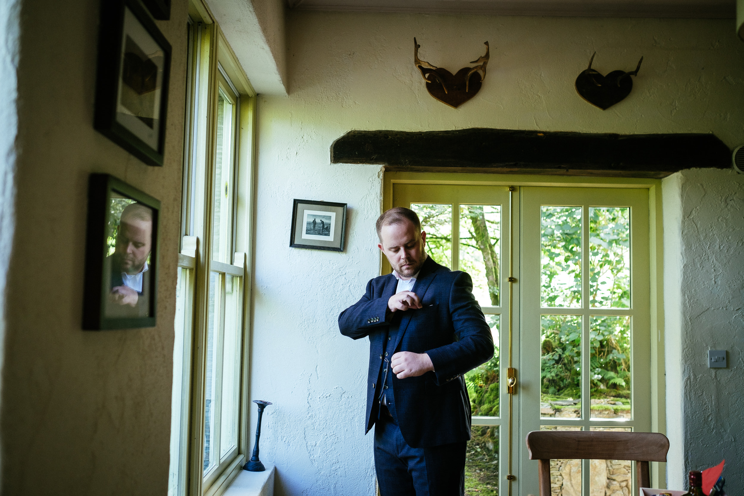 groom adjusting jacket at grouse lodge wicklow