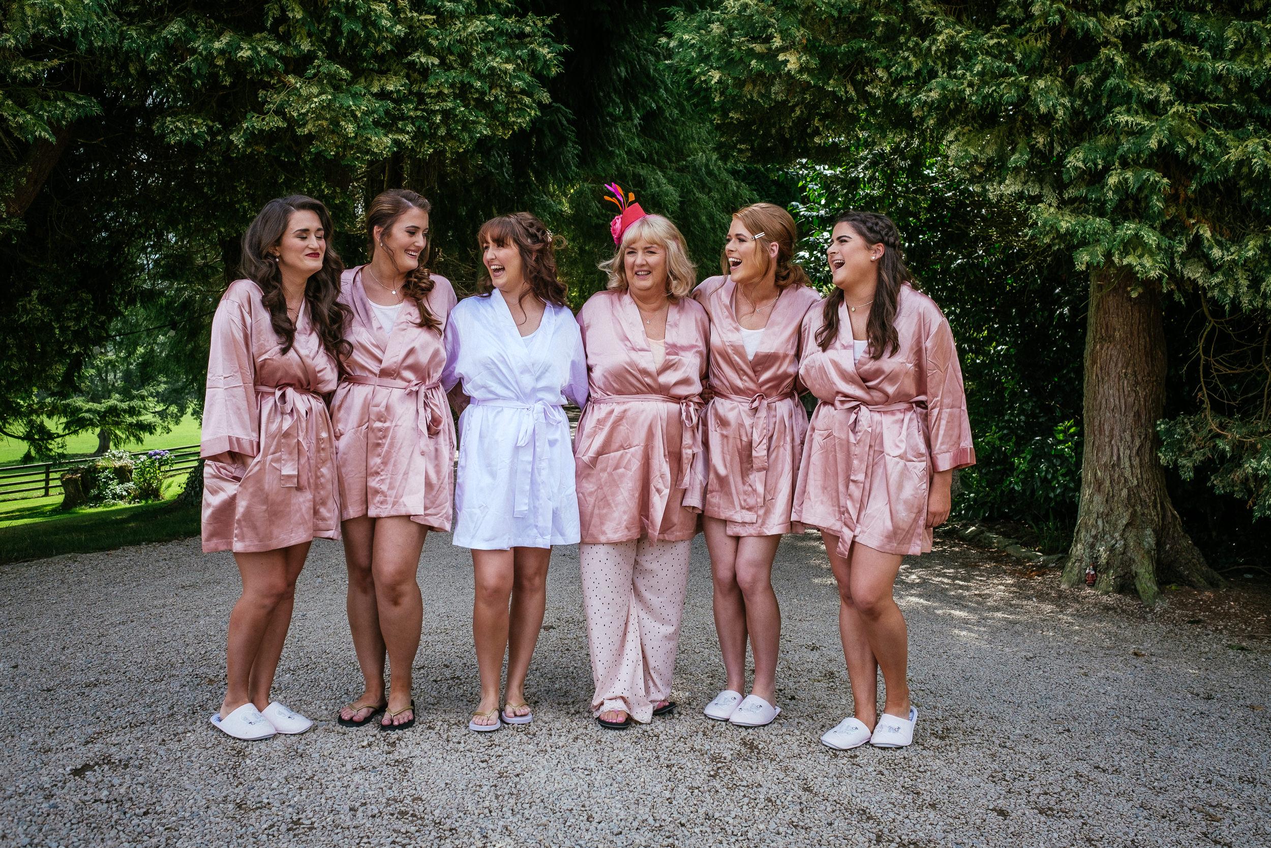 bride and bridesmaids laughing at ballybeg house