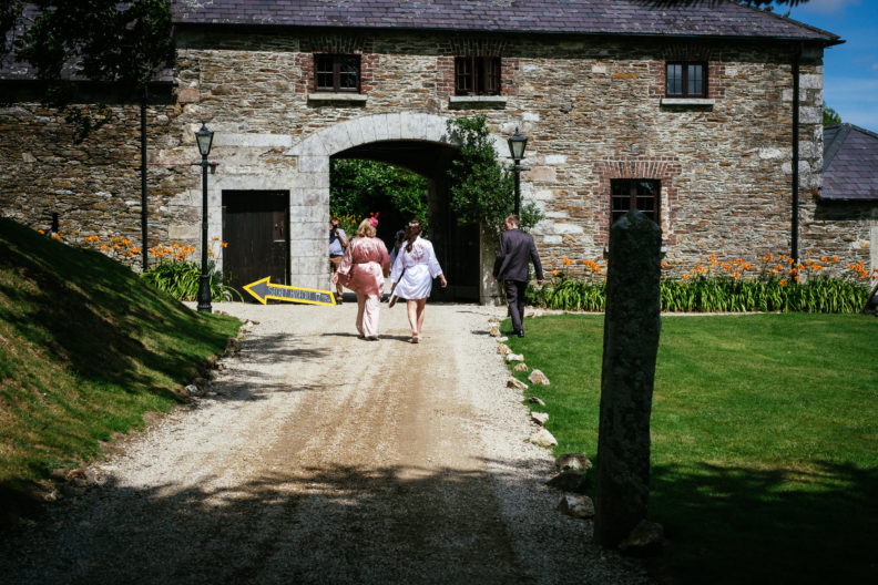 bride walking outside at ballybeg house
