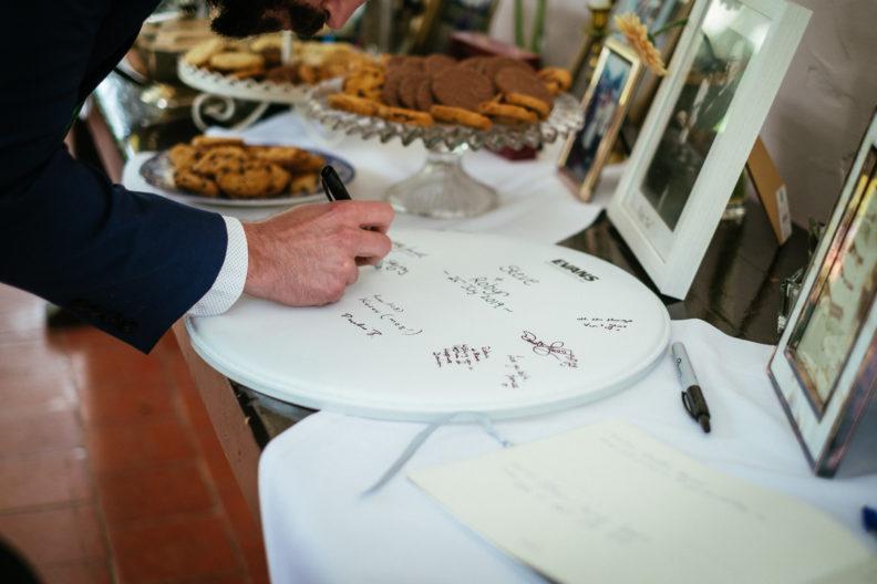 man signing guestbook