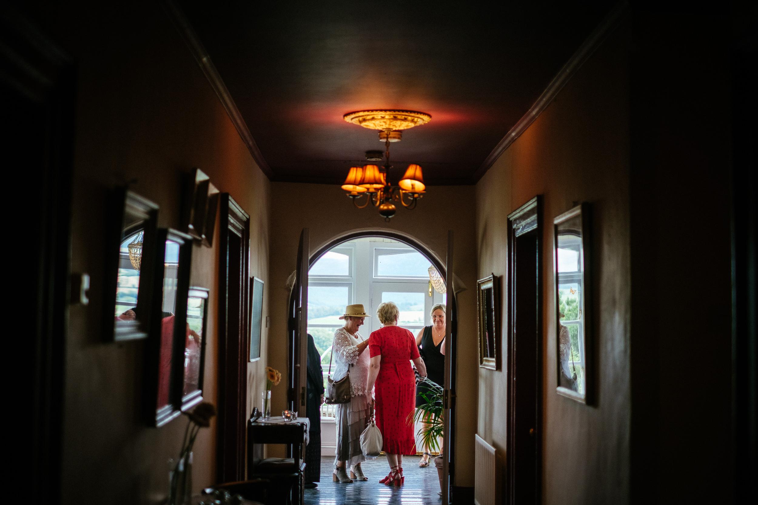women chatting inside ballybeg house
