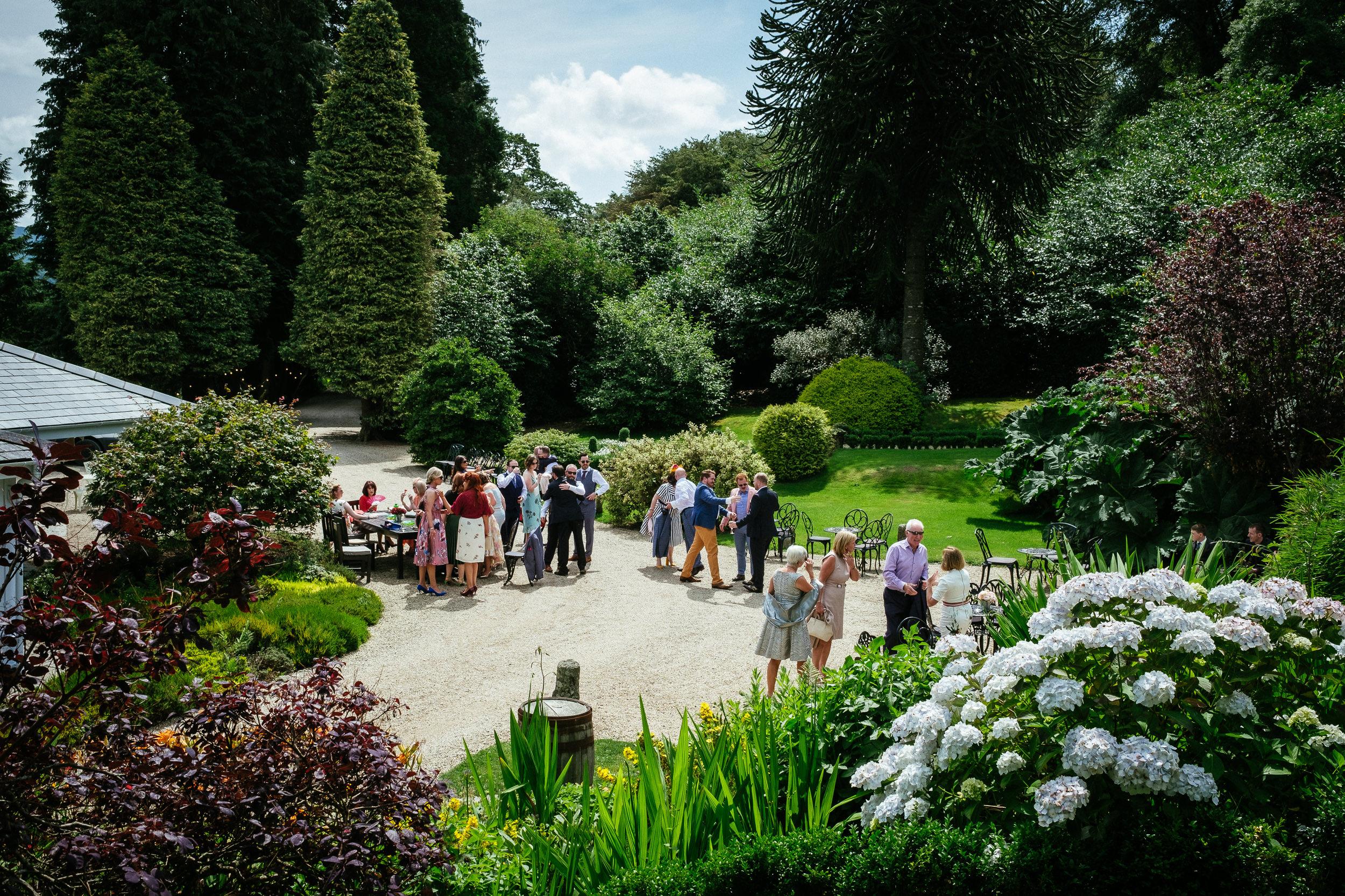 guests in garden of ballybeg house