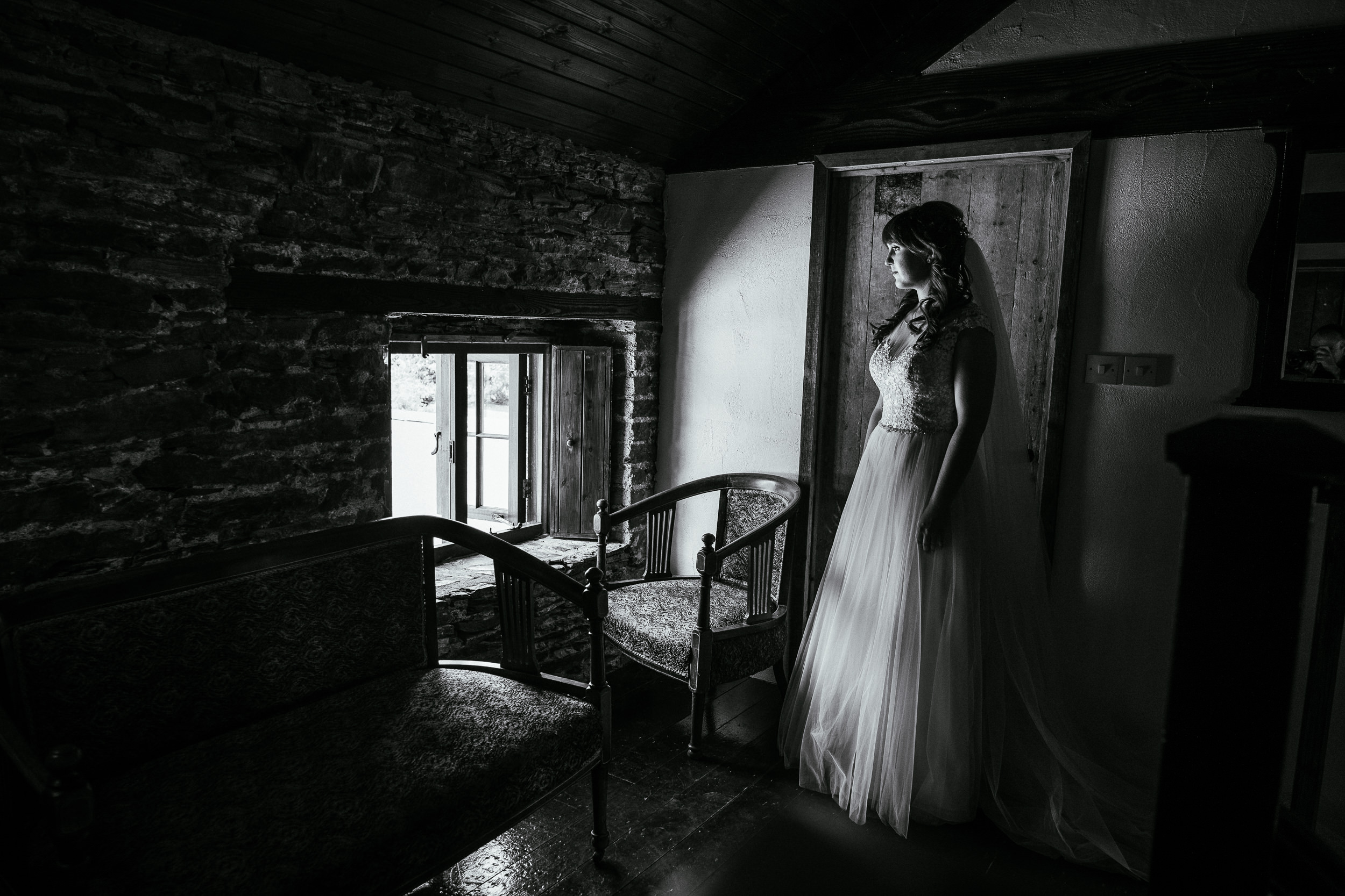 bride standing by window at ballybeg house