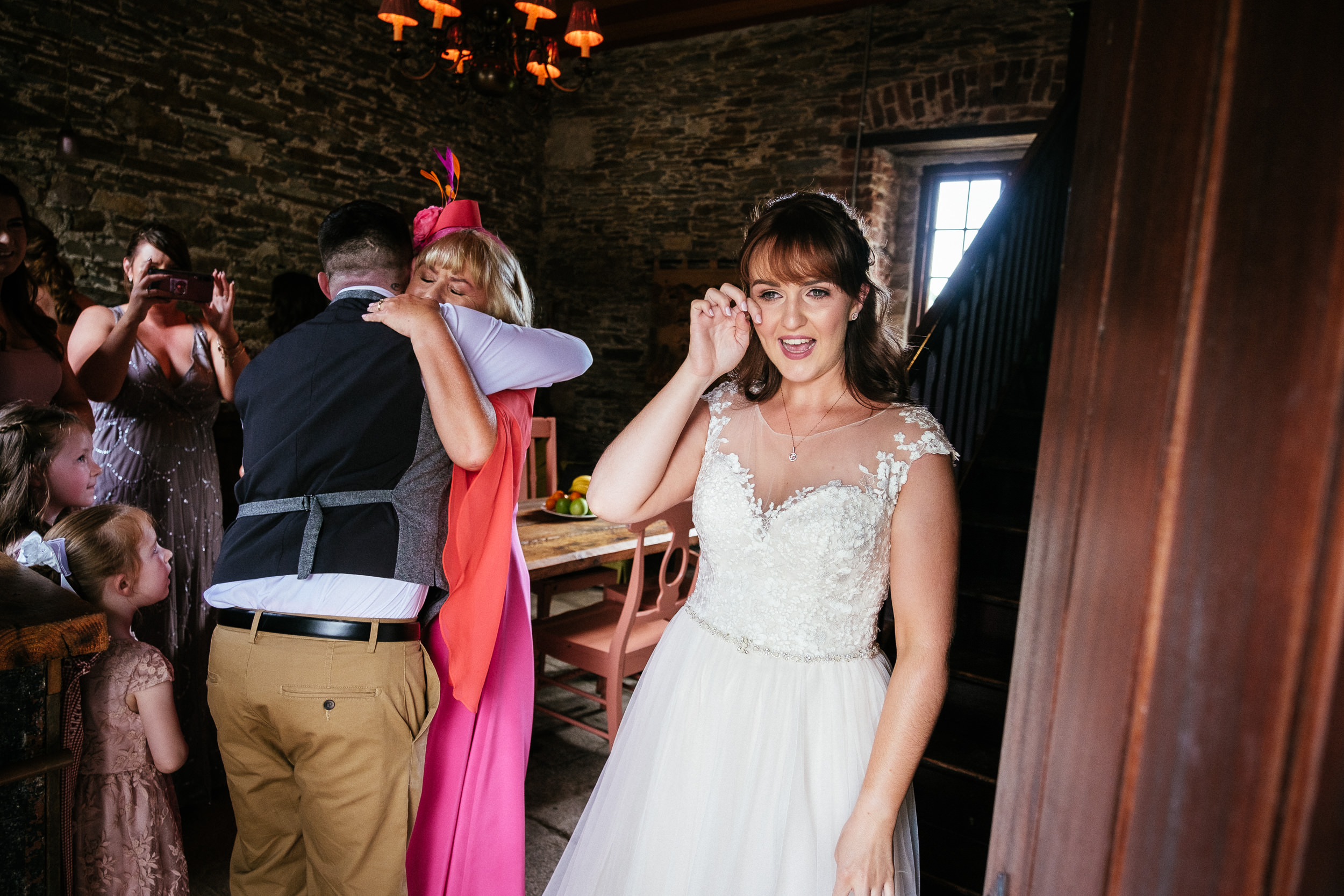 bride wiping tears from her eyes at ballybeg house