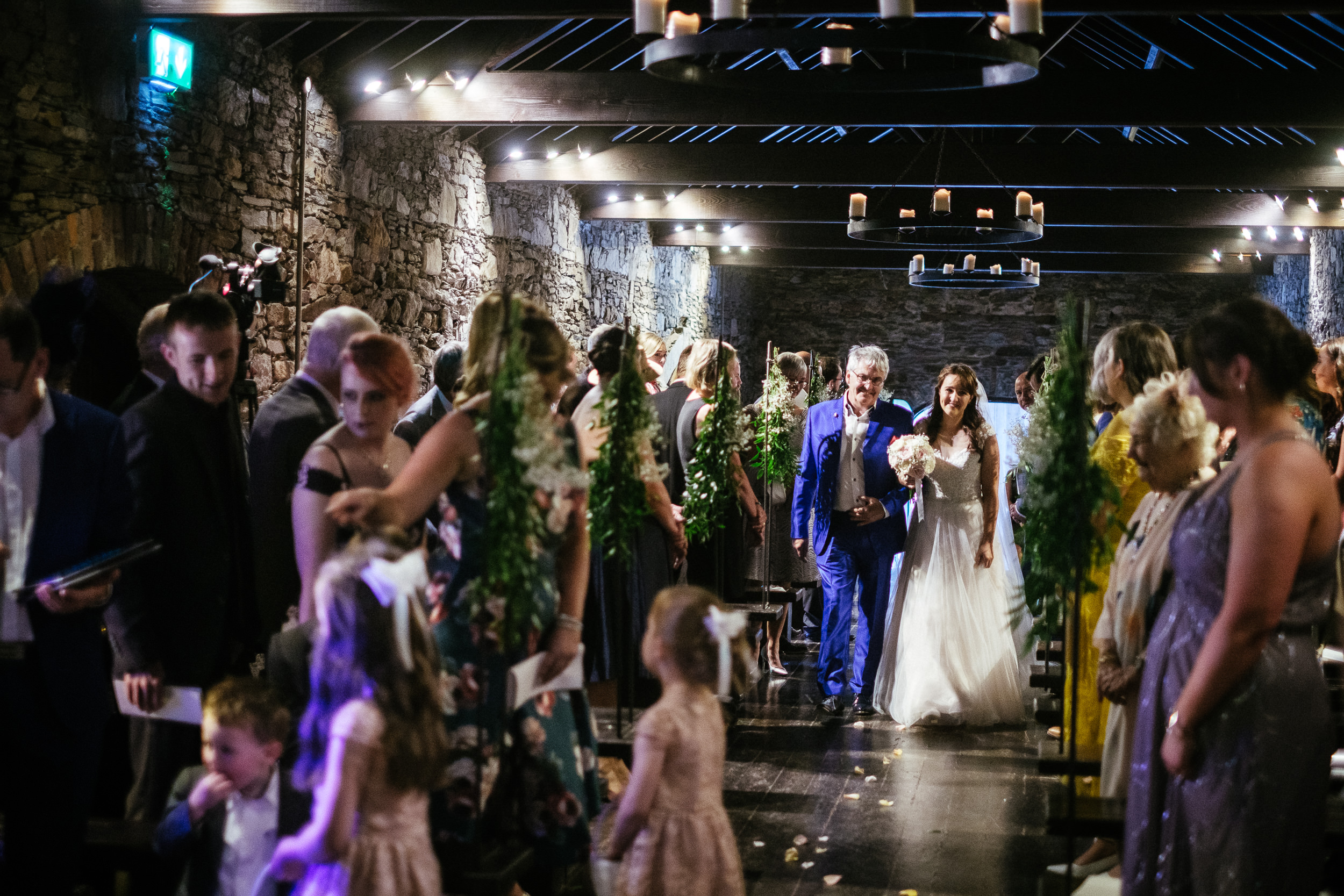 bride walking down the aisle with her father in the barn at ballybeg house