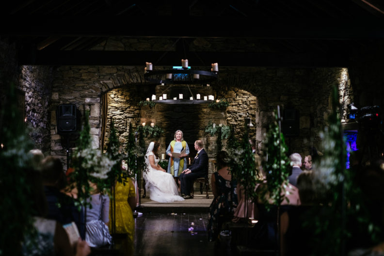 wedding ceremony in the barn at ballybeg house