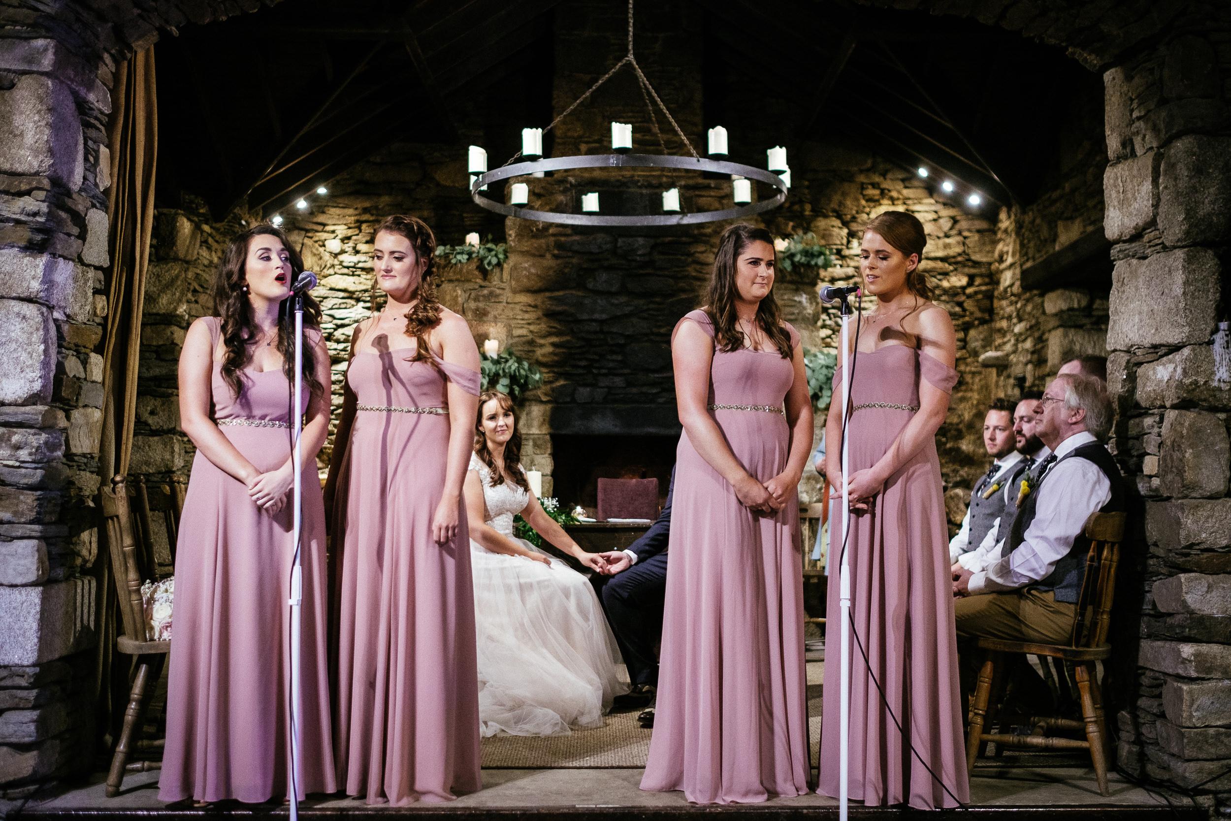 bridesmaids singing during ceremony at ballybeg house