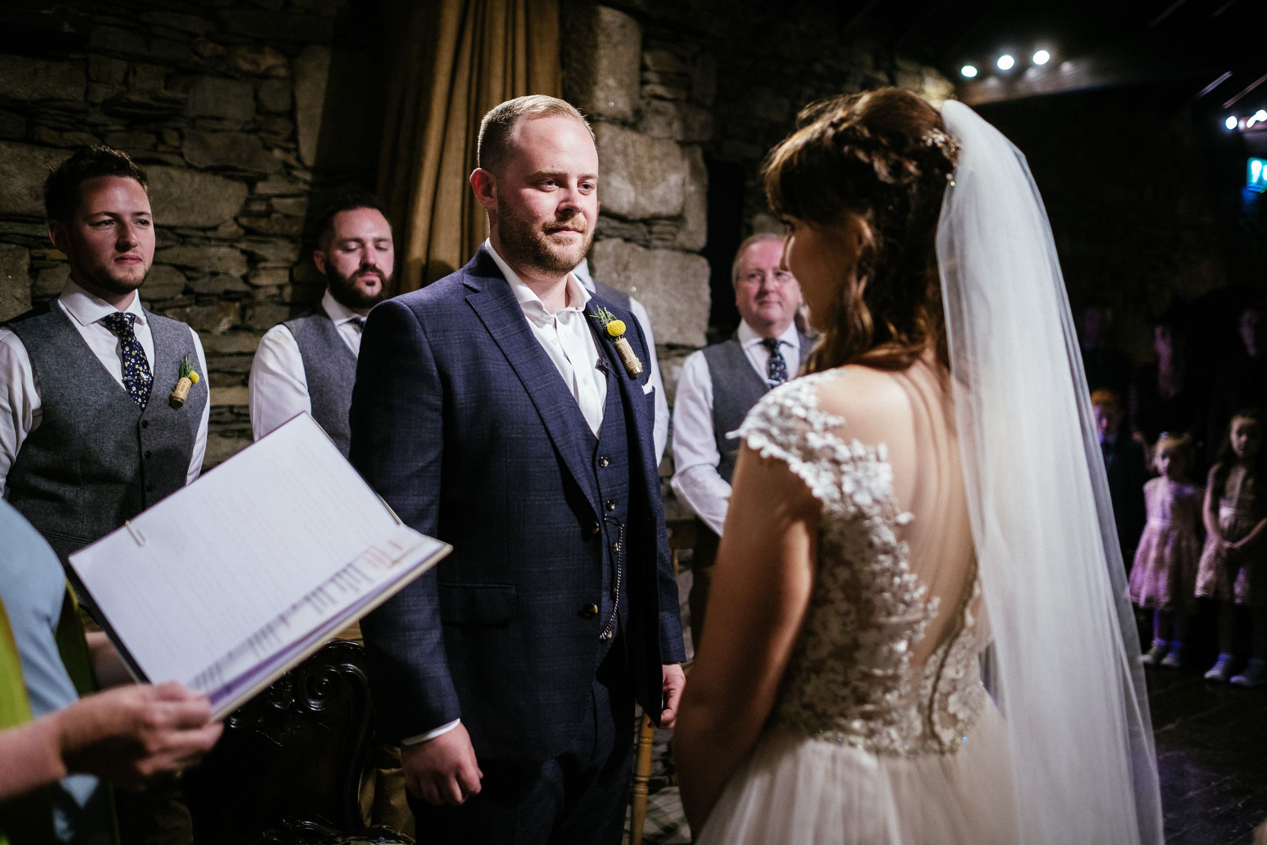 bride and groom exchanging vows at civil ceremony at ballybeg house