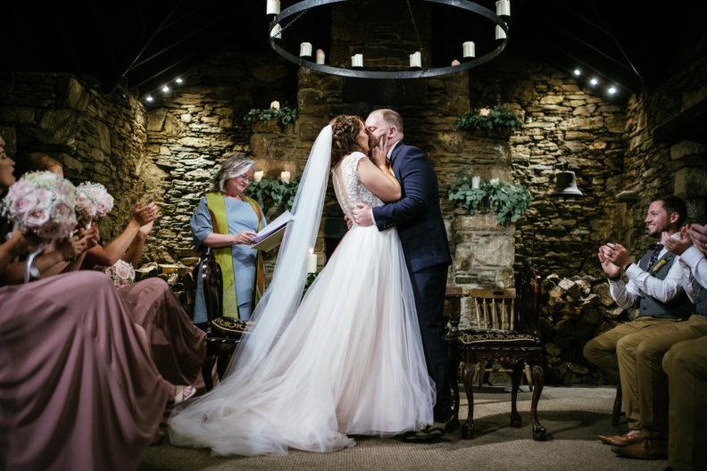 bride and groom first kiss at ballybeg house