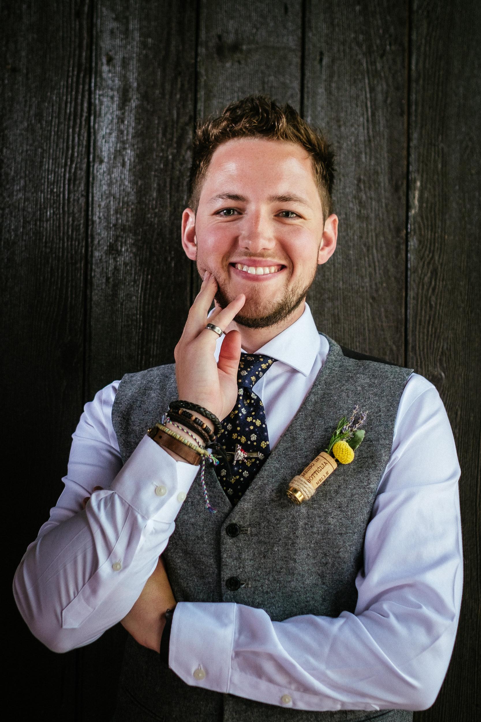 groomsman smiling at camera