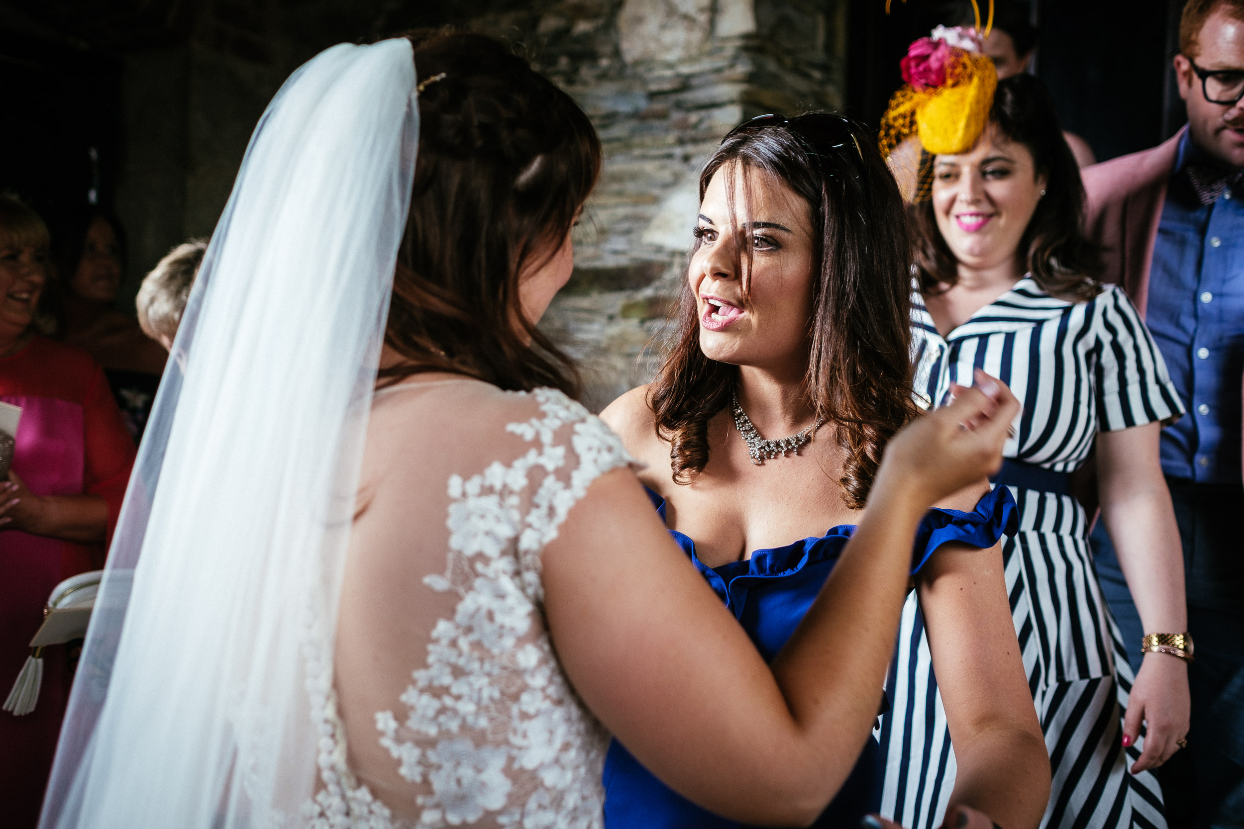 bride chatting to wedding guest