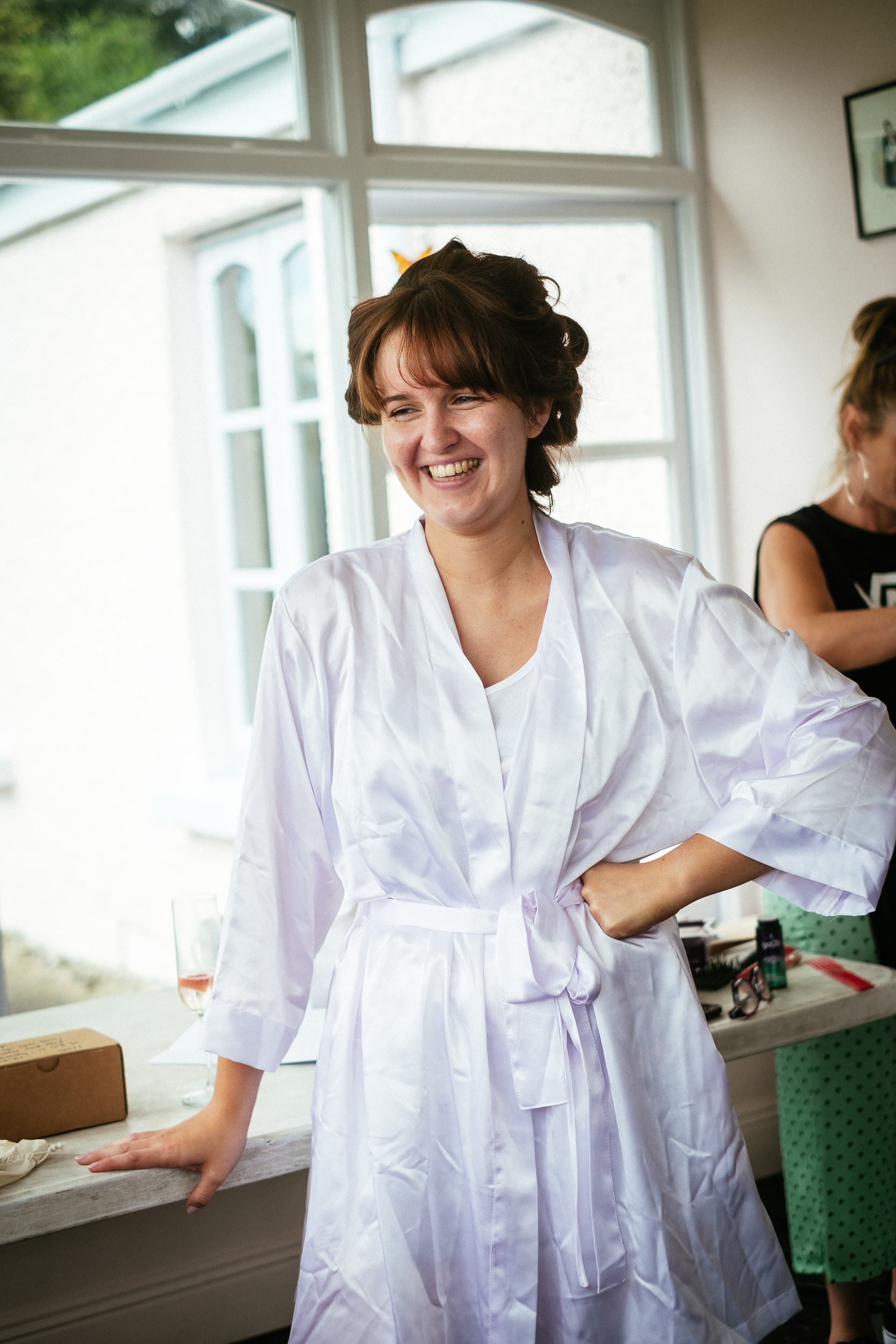 bride in dressing gown laughing