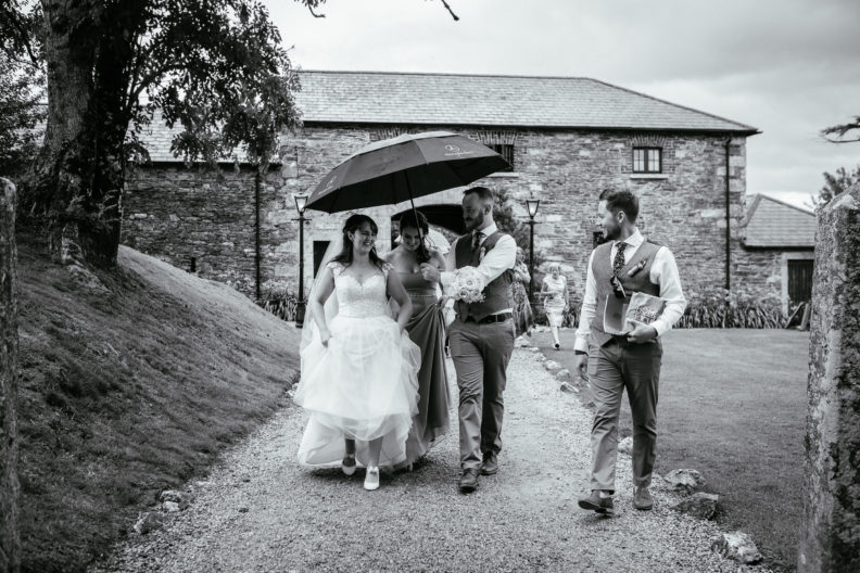 bridal party walking at ballybeg house