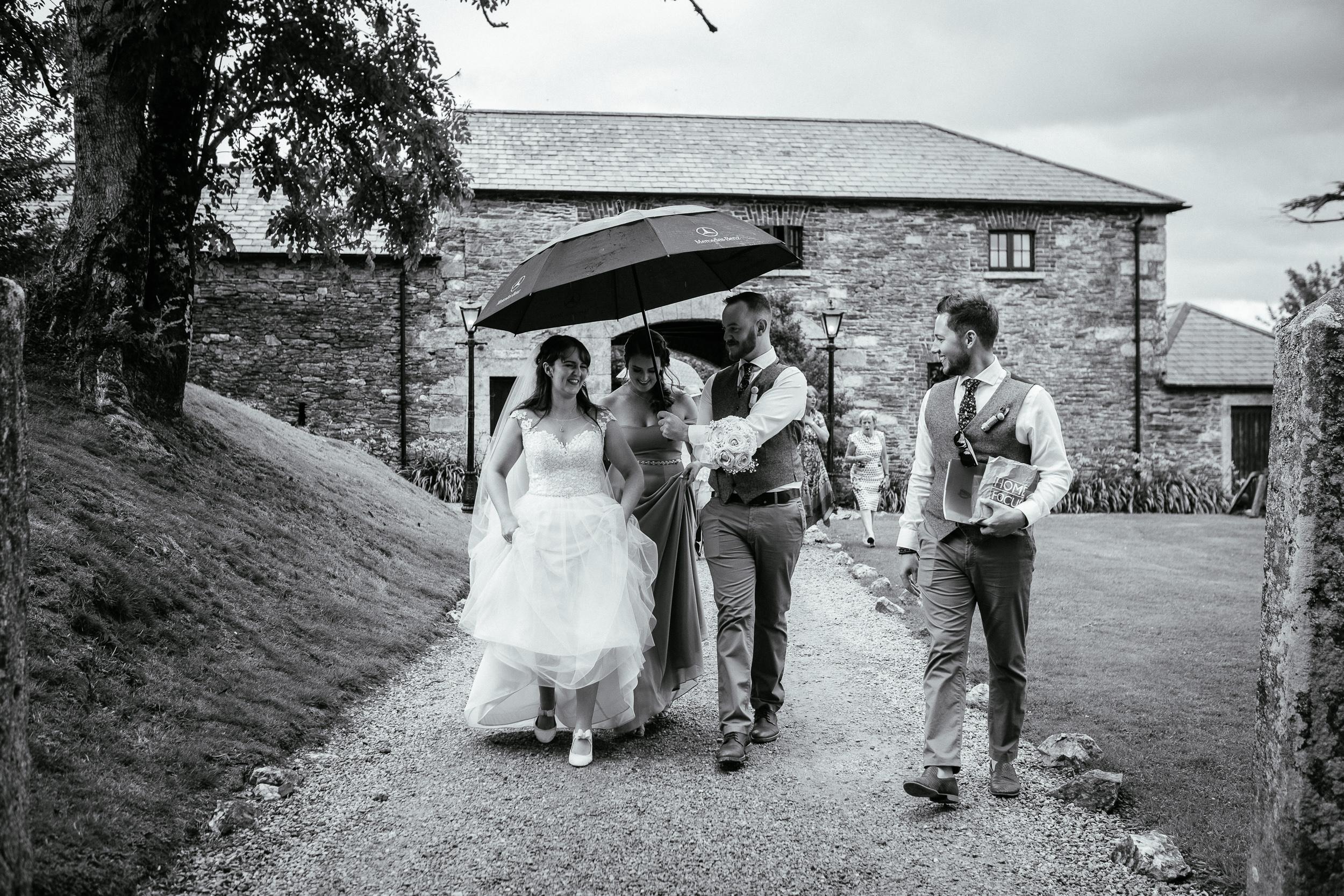 bridal party walking at ballybeg house