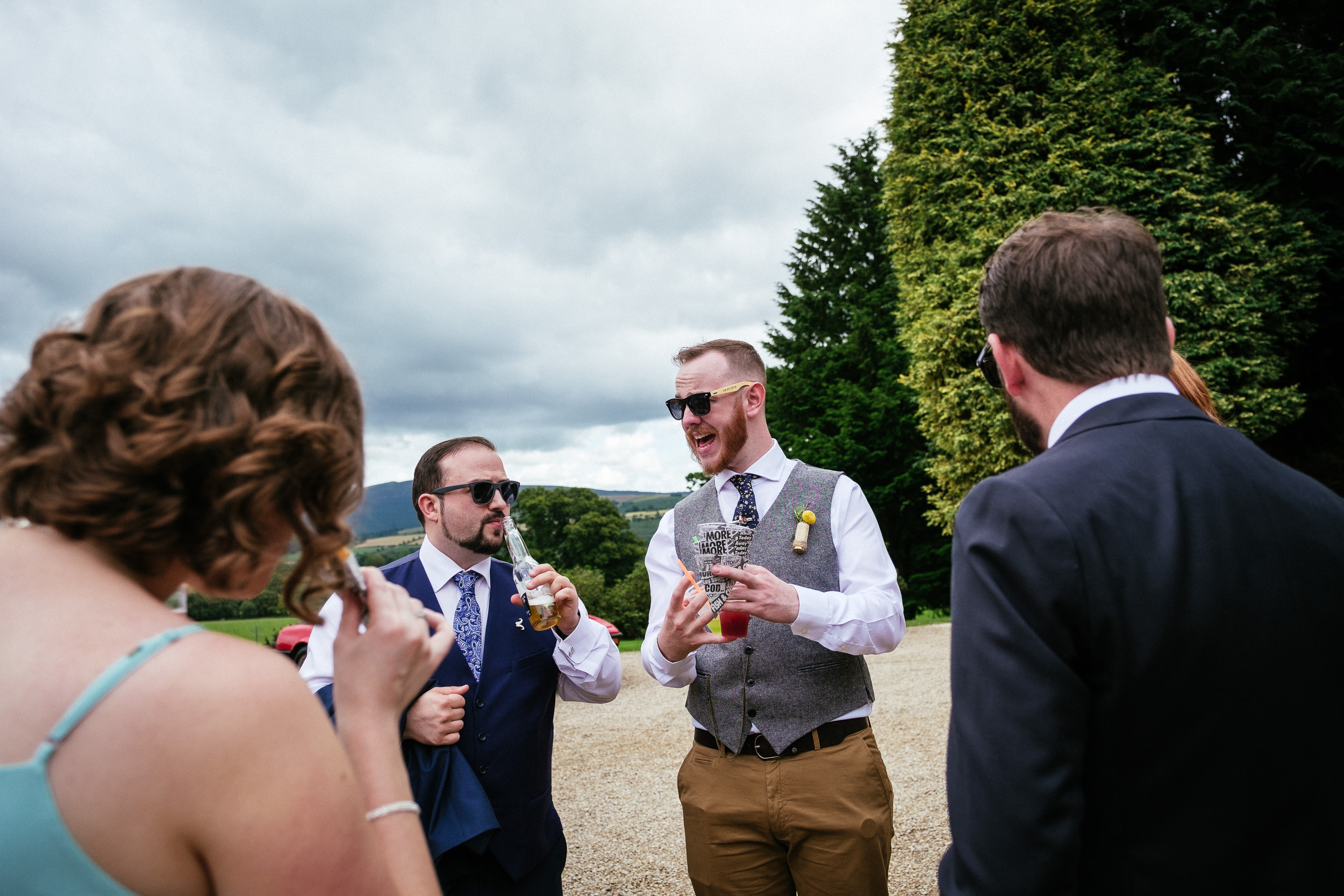 groomsman laughing with guests